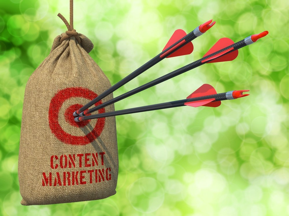 Content Marketing - Three Arrows Hit in Red Target on a Hanging Sack on Natural Bokeh Background..jpeg