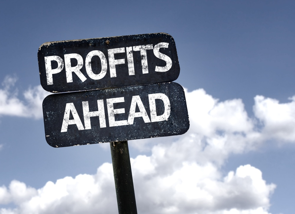 Profits Ahead sign with clouds and sky background.jpeg