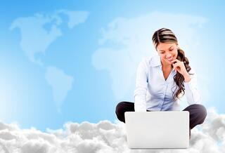 Business woman cloud computing looking very happy using wireless technology.jpeg